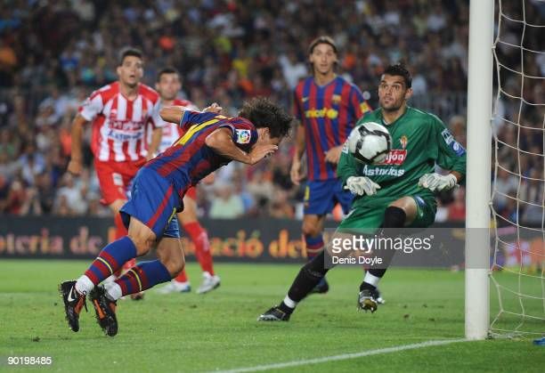 Bojan Krkic of Barcelona scores Barcelona's first goal during the La Liga match between Barcelona and Sporting Gijon at the Nou Camp stadium on...