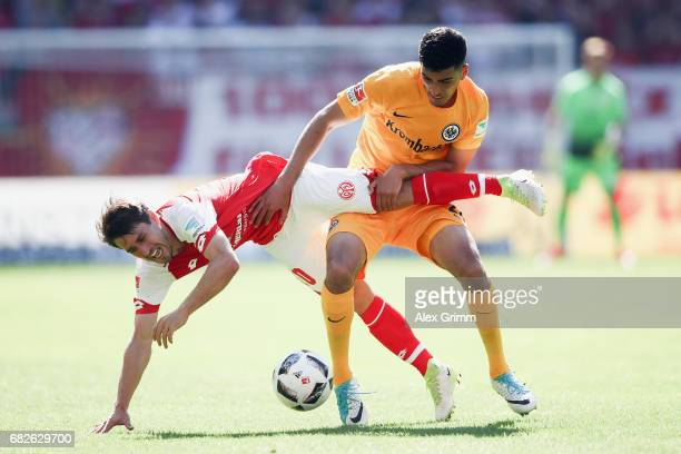 Bojan Krkic of Mainz is challenged by Aymane Barkok of Frankfurt during the Bundesliga match between 1 FSV Mainz 05 and Eintracht Frankfurt at Opel...