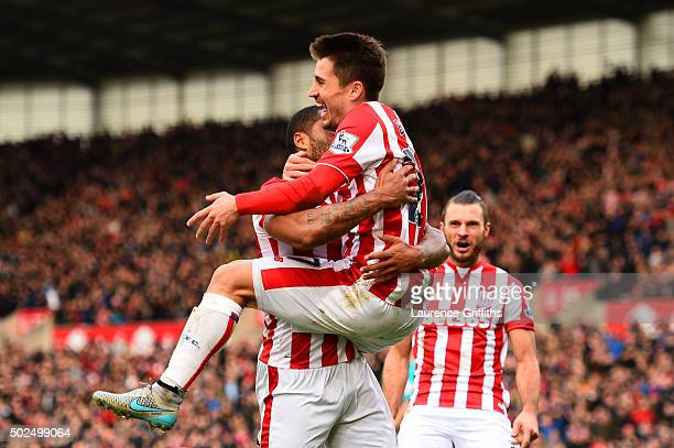 Bojan Krkic of Stoke City celebrates with teammates including Marko Arnautovic of Stoke City after scoring the opening goal during the Barclays...