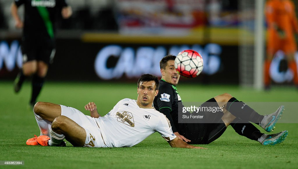 Bojan Krkic of Stoke City challenges Jack Cork (l) of Swansea City during the Barclays Premier League match between Swansea City and Stoke City at Liberty Stadium on October 19, 2015 in Swansea, Wales.