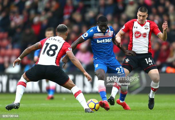 Bojan Krkic of Stoke City is challenged by Mario Lemina of Southampton and Oriol Romeu of Southampton during the Premier League match between...