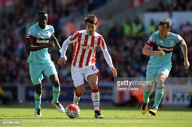 Bojan Krkic of Stoke City is chased down by Mark Noble of West Ham United during the Barclays Premier League match between Stoke City and West Ham...