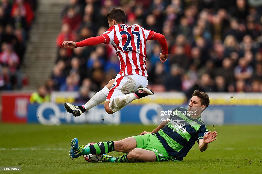 Bojan Krkic of Stoke City is tackled by Federico Fernandez of Swansea City during the Barclays Premier League match between Stoke City and Swansea City at Britannia Stadium on April 2, 2016 in Stoke on Trent, England.