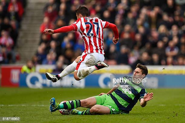 Bojan Krkic of Stoke City is tackled by Federico Fernandez of Swansea City during the Barclays Premier League match between Stoke City and Swansea...