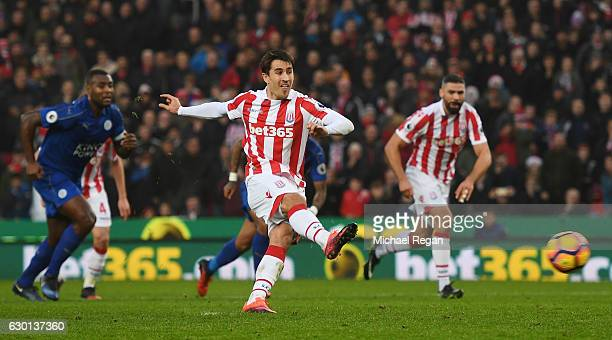 Bojan Krkic of Stoke City scores his sides first goal from the penalty spot during the Premier League match between Stoke City and Leicester City at...