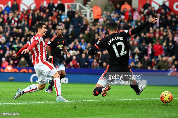 Bojan Krkic of Stoke City scores the opening goal past Chris Smalling of Manchester United during the Barclays Premier League match between Stoke...