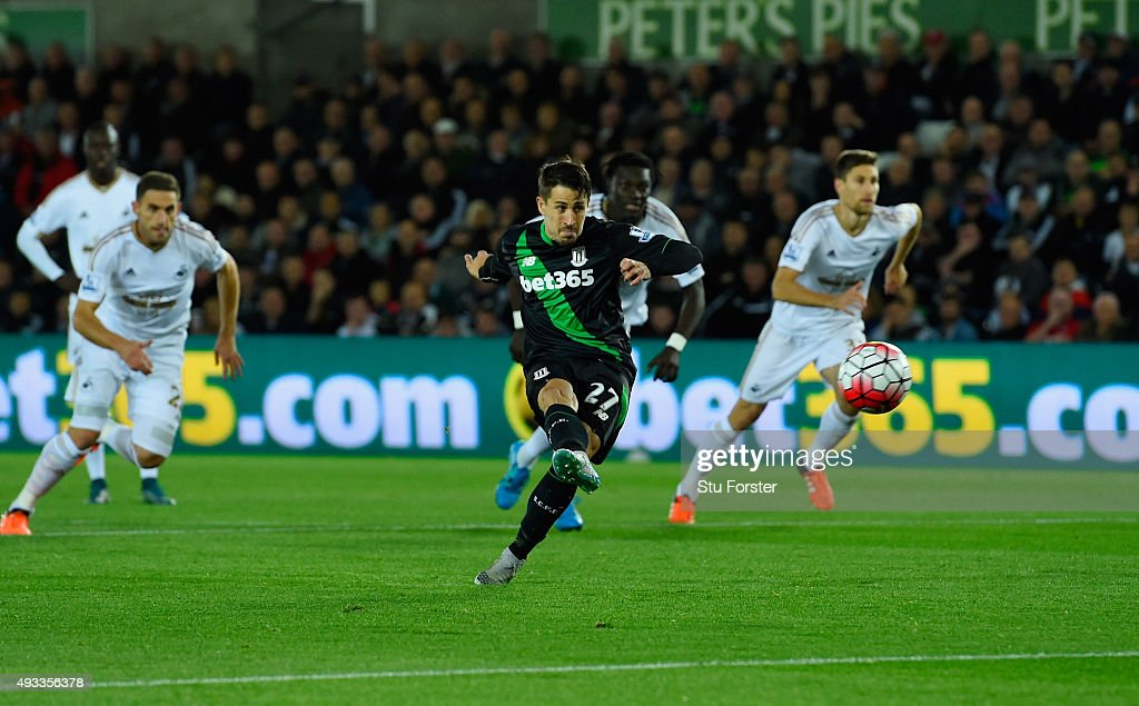 Bojan Krkic of Stoke City scores their first goal from the penalty spot during the Barclays Premier League match between Swansea City and Stoke City at Liberty Stadium on October 19, 2015 in Swansea, Wales.