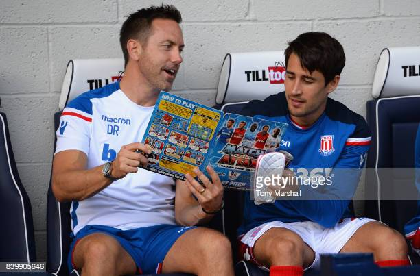 Bojan of Stoke City signs an autograph for a fan during the Premier League match between West Bromwich Albion and Stoke City at The Hawthorns on...