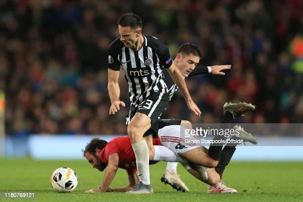 Bojan Ostojic of Belgrade and Sasa Zdjelar of Belgrade combine to shut out Juan Mata of Man Utd during the UEFA Europa League group L match between...