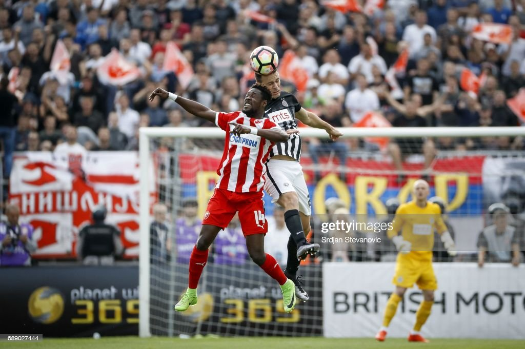 Bojan Ostojic (R) of Partizan jump for the ball over Richard Boakye (L) of Crvena Zvezda during the final match of Serbian Cup between Fc Partizan and Fc Crvena Zvezda on May 27, 2017 in Belgrade, Serbia.