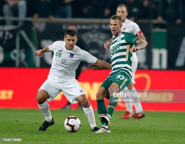 Bojan Sankovic of Ujpest FC covers the ball from Roland Varga of Ferencvarosi TC during the Hungarian OTP Bank Liga match between Ferencvarosi TC and...