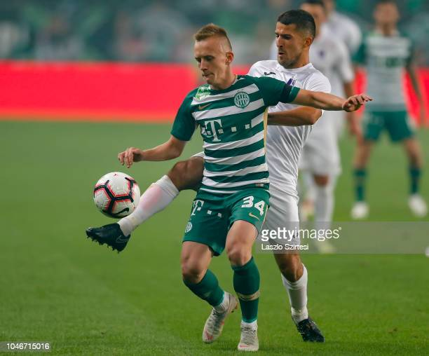 Bojan Sankovic of Ujpest FC fights for the ball with Ivan Petryak of Ferencvarosi TC during the Hungarian OTP Bank Liga match between Ferencvarosi TC...