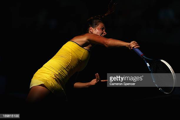 Bojana Jovanovski of Serbia serves in her fourth round match against Sloane Stephens of the United States during day eight of the 2013 Australian...