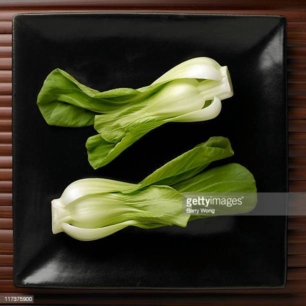 Bok choy on black plate