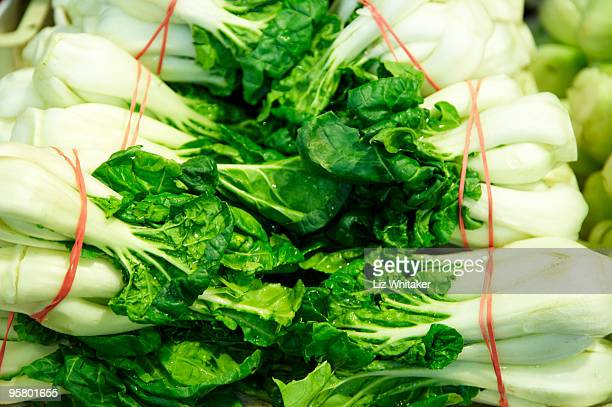 Bok choy piled up on market stall