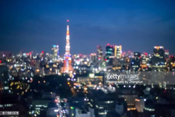 Bokeh aerial view of Tokyo cityscape landmarks as Tokyo tower and Roppongi hills at night, Minato ward, Tokyo, Japan.