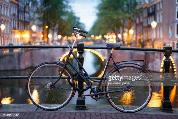 bokeh bicycle, amsterdam, holland - amsterdam stock pictures, royalty-free photos & images