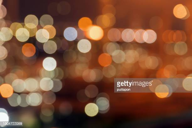 bokeh, defocused image of illuminated lights at night - lightweight stock pictures, royalty-free photos & images