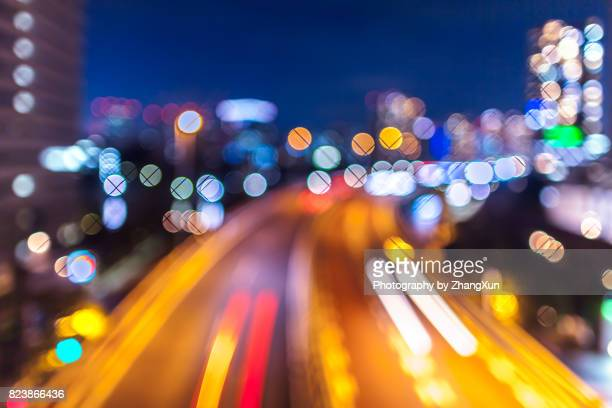 Bokeh image of aerial view of Tokyo cityscape with highway busy traffic at night, Tennoz Isel, Tokyo, Japan.