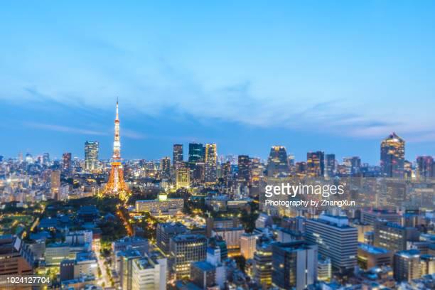Bokeh image of Tokyo skyline with landmarks as Tokyo tower, Roppongi hills and Toranomon hills at sunset, Minato ward, Tokyo city, Japan.