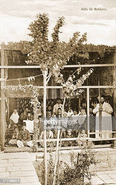 Bokharian Jewish community men and women at the festival of Sukkot Wearing traditional cosotume One man holding holding a lulav Central Asia...