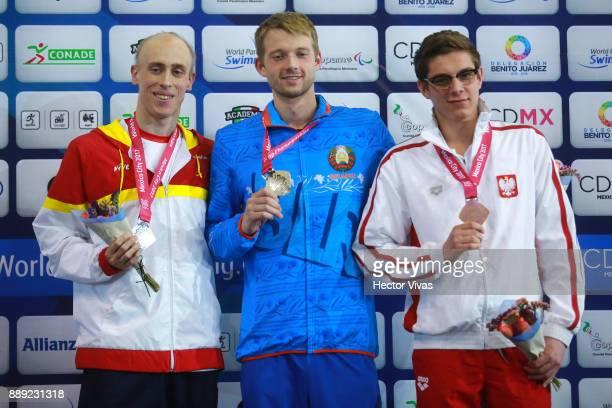 Boki Ihar of Belarus Gold Medal Salguero Oteiza of Spain Silver Medal and Kamil Rzetelski Bronze Medal pose after the men's 100 m Freestyle S13 Final...