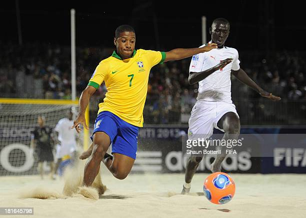 Bokinha of Brazil is challenged by Babacar Fall of Senegal during the FIFA Beach Soccer World Cup Tahiti 2013 Group C match between Brazil and...