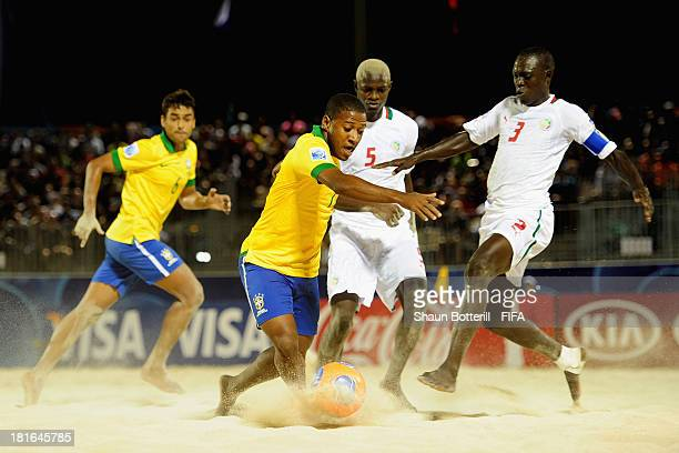 Bokinha of Brazil is challenged by Ngalla Sylla of Senegal during the FIFA Beach Soccer World Cup Tahiti 2013 Group C match between Brazil and...