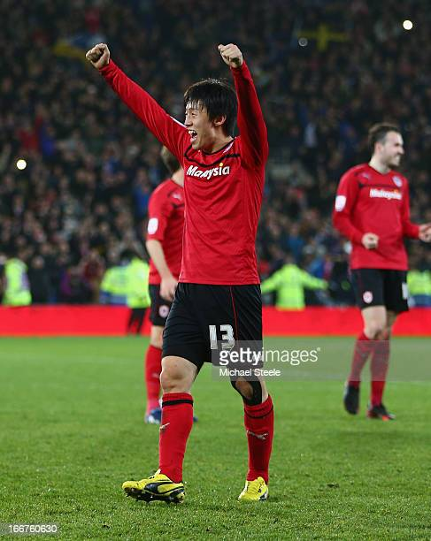 Bo-Kyung Kim of Cardiff City celebrates his team's promotion to the Premier League at the end of the npower Championship match between Cardiff City...