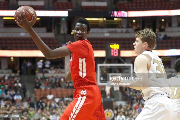 Bol Bol of Mater Dei High School looks for the open pass during the game against Bishop Montgomery High School at the Honda Center on March 4 2017 in...