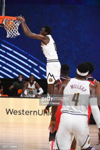 Bol Bol of the Denver Nuggets dunks the ball against the Washington Wizards during a scrimmage on July 22, 2020 at HP Field House at ESPN Wide World...