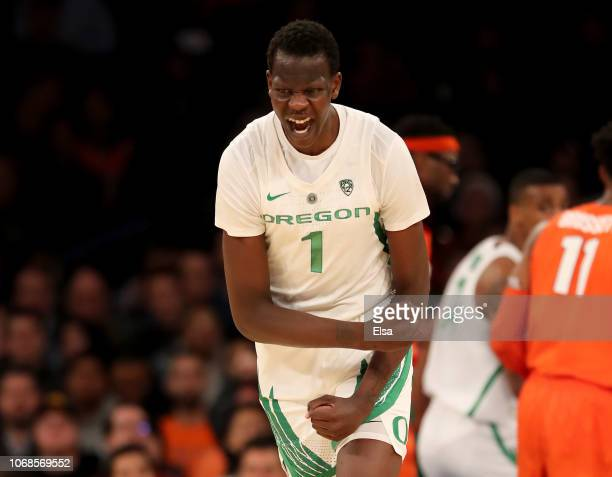 Bol Bol of the Oregon Ducks celebrates his three point shot in the second half against the Syracuse Orange during the 2K Empire Classic at Madison...