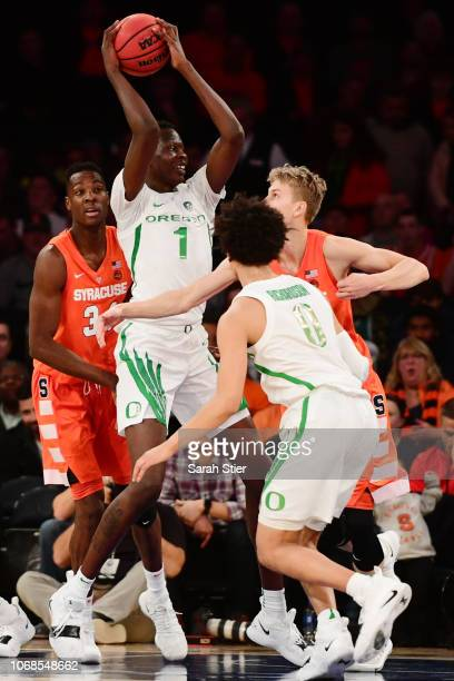 Bol Bol of the Oregon Ducks gets a rebound in the first half of the game against Syracuse Orange during the 2k Empire Classic at Madison Square...