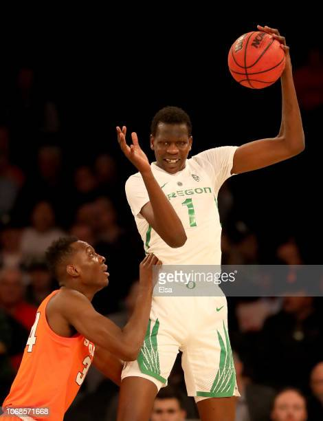 Bol Bol of the Oregon Ducks grabs the rebound as Bourama Sidibe of the Syracuse Orange defends during the 2K Empire Classic at Madison Square Garden...