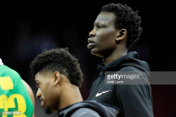 Bol Bol of the Oregon Ducks looks on from the bench against the Virginia Cavaliers during the second half of the 2019 NCAA Men's Basketball...
