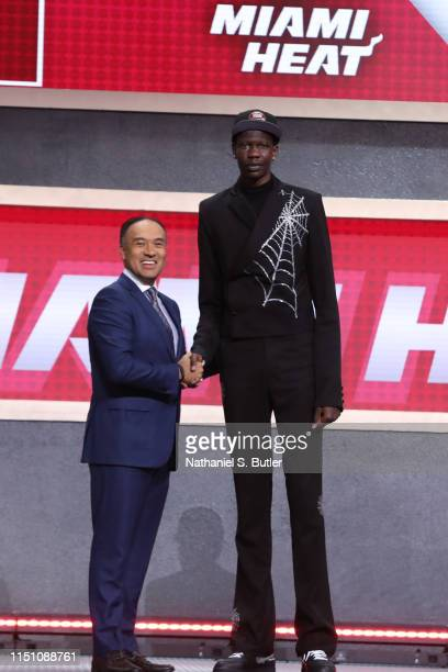 Bol Bol shakes hands with NBA Deputy Commissioner Mark Tatum after being selected number forty four overall by the Miami Heat during the 2019 NBA...