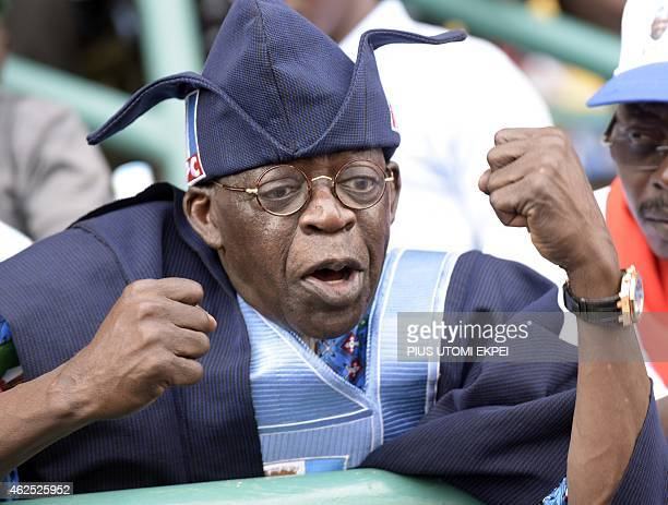 Bola Tinubu, one of the leaders of Nigeria's leading opposition All Progressive Congress, tries to calm the crowd after violence broke out during a...