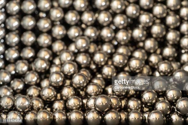bolas de metal amontonadas - spare part stock pictures, royalty-free photos & images