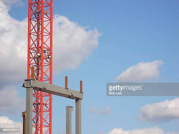 CONTENT] bold abstract building construction elements against a bright blue sky