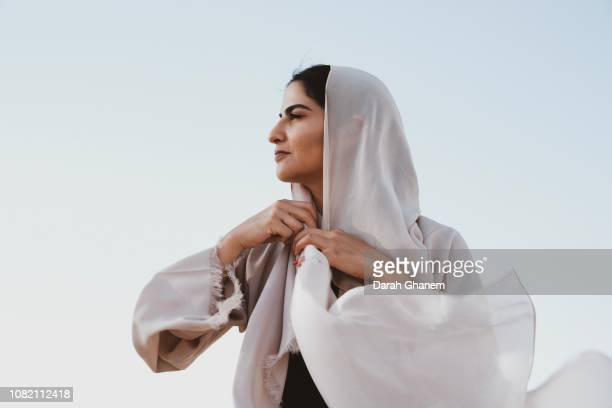 a bold muslim woman - united arab emirates stock pictures, royalty-free photos & images