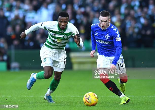 Boli Bolingoli of Celtic and Ryan Kent of Rangers battle for possession during the Ladbrokes Premiership match between Celtic and Rangers at Celtic...