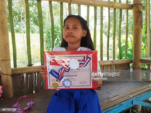 T'boli kid graduating elementary after her father had financed her studies through gold mining in Kematu South Cotabato