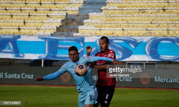 Bolivar and Wilstermann play a match of the Professional Division of Bolivian Soccer in an empty stadium to prevent the expansion of the coronavirus...