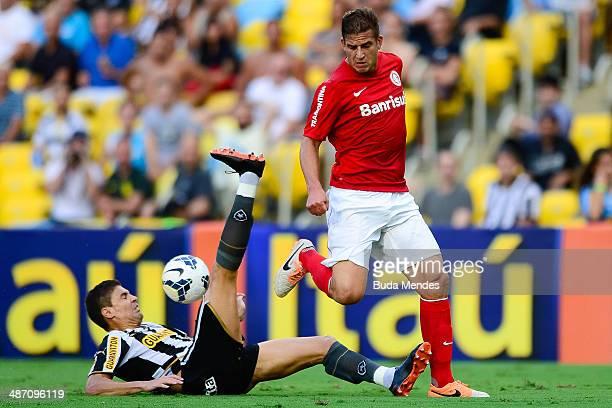 Bolivar of Botafogo struggles for the ball with Rafael Moura of Internacional during a match between Botafogo and Internacional as part of...