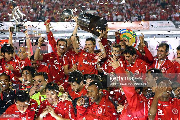 Bolivar of Brazilian Internacional holds up the Libertadores Cup after the final football match against Mexican Chivas at Beira Rio stadium in Porto...