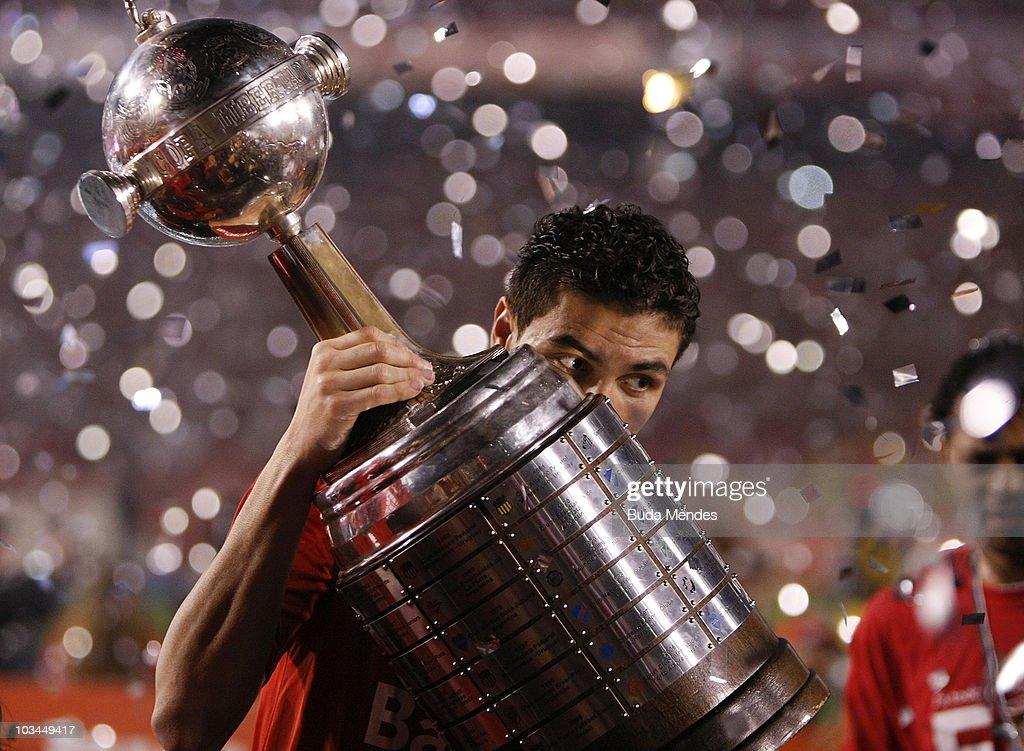 Bolivar of Internacional celebrates championship title after defeating Chivas during a final match as part of the 2010 Copa Santander Libertadores at Beira Rio Stadium on August 18, 2010 in Porto Alegre, Brazil.