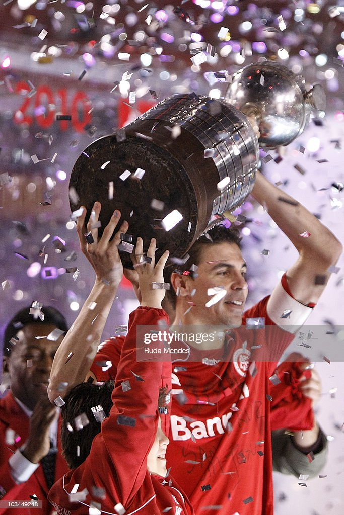 Bolivar of Internacional holds the championship trophy after a match against Chivas Guadalajara as part of the 2010 Copa Santander Libertadores at Beira Rio Stadium on August 18, 2010 in Porto Alegre, Brazil.