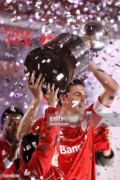Bolivar of Internacional holds the championship trophy after a match against Chivas Guadalajara as part of the 2010 Copa Santander Libertadores at...