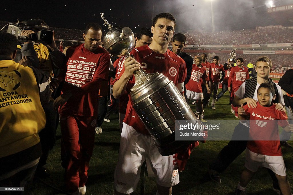 Bolivar of Internacional lift the trophy after winning the match against Mexico's Chivas Guadalajara as part of Final 2010 Copa Santander Libertadores at Beira Rio Stadium on August 18, 2010 in Porto Alegre, Brazil.