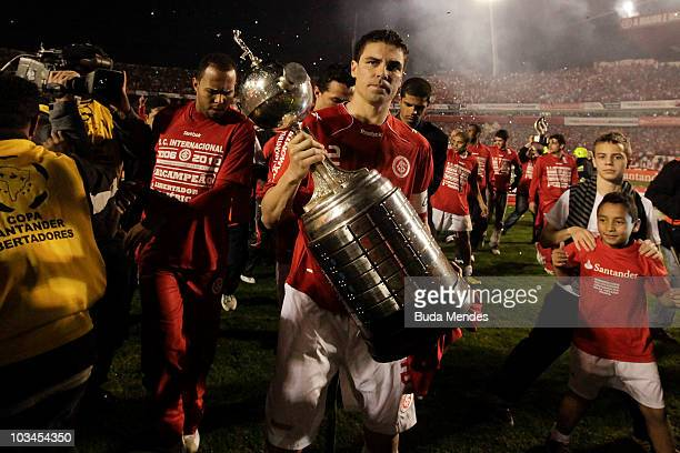 Bolivar of Internacional lift the trophy after winning the match against Mexico's Chivas Guadalajara as part of Final 2010 Copa Santander...